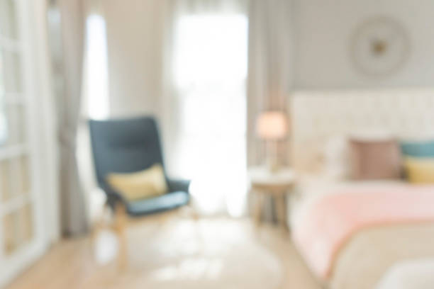 blurred bedroom with pillows and doll stock photo