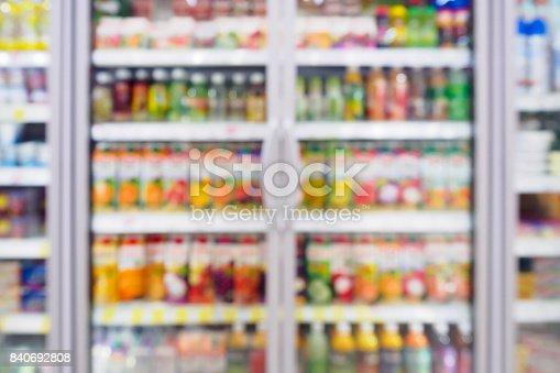922721264 istock photo Blurred beverages drinks shelf refrigerator in the supermarket 840692808