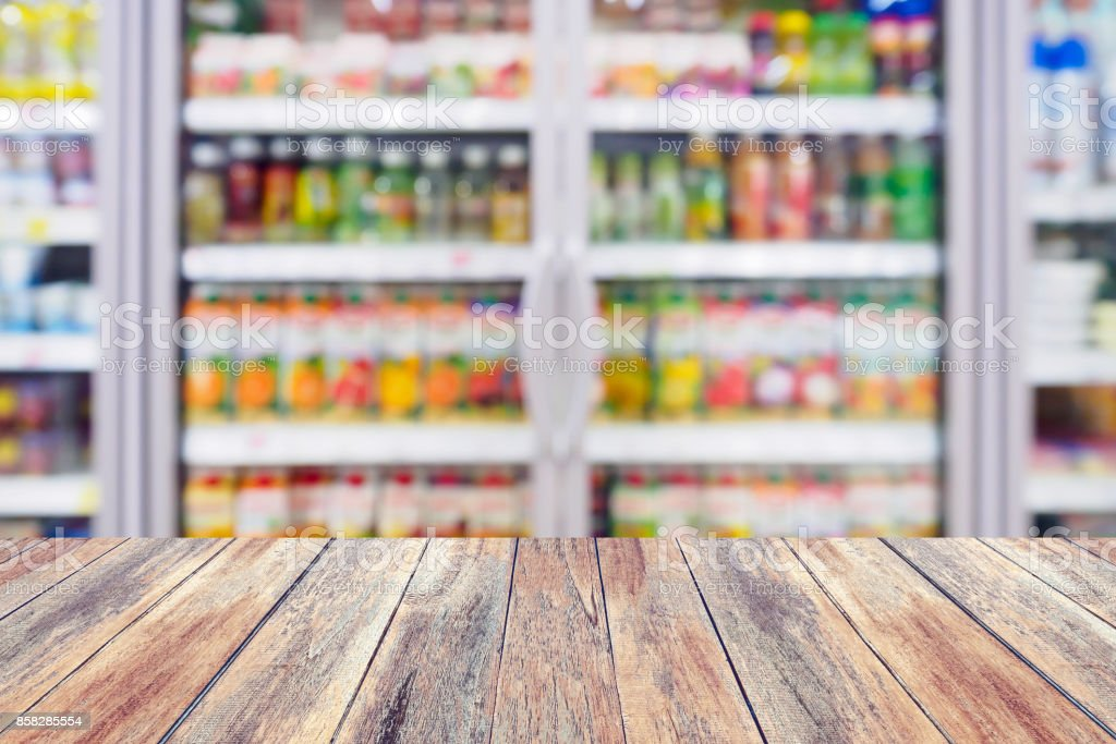 Blurred beverages drinks shelf refrigerator in the supermarket stock photo