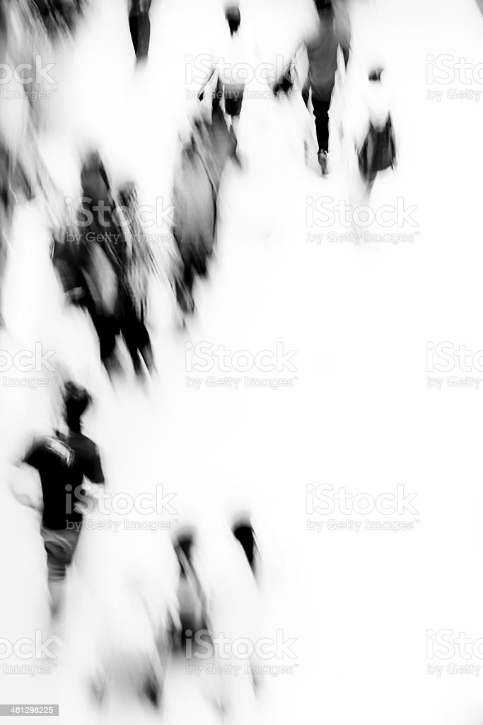 A blurred black and white image of people in a public place stock photo