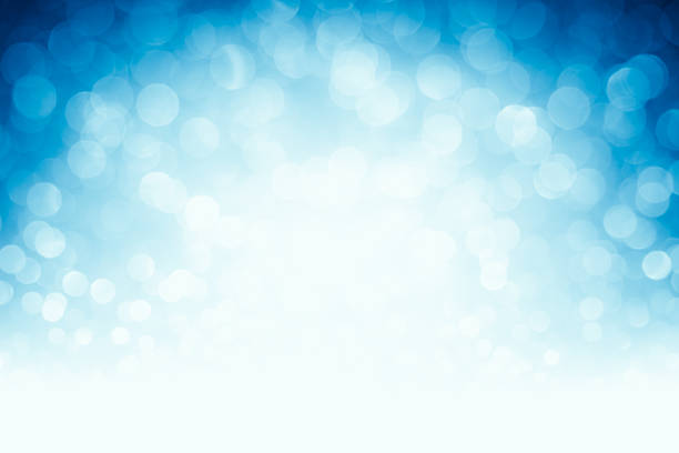 blurred blue defocused lights and sparkles background - high key stock pictures, royalty-free photos & images