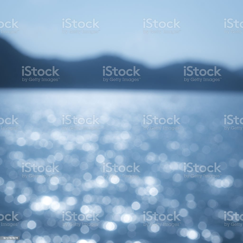 blurred blue sea background abstract light white silver particle and