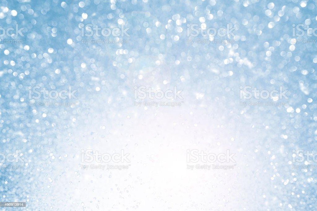 Blurred blue sparkles background bokeh stock photo