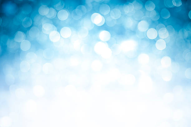 blurred blue sparkles background with darker top corners - high key stock pictures, royalty-free photos & images