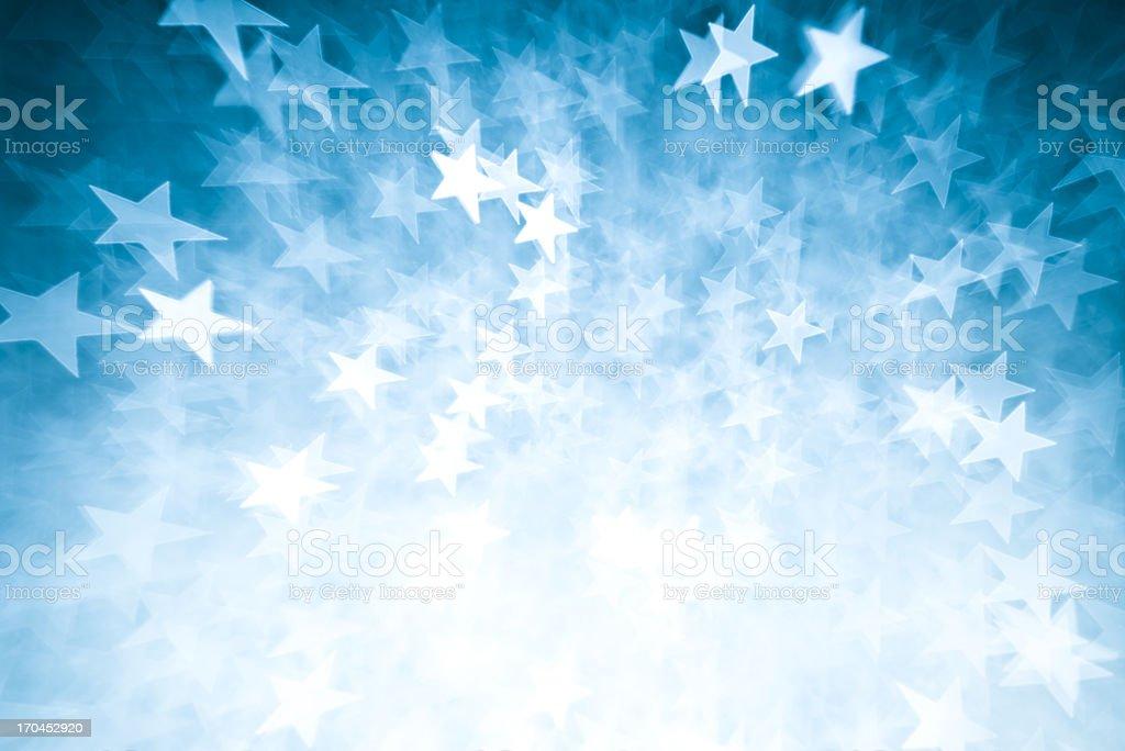 Blurred blue star shape lights stock photo