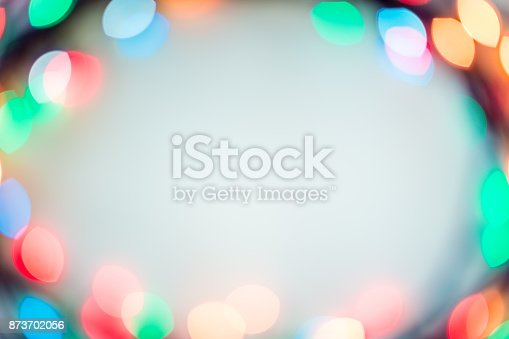 Blurred bokeh christmas lights with New Year ornaments in warm tone background. Copy space