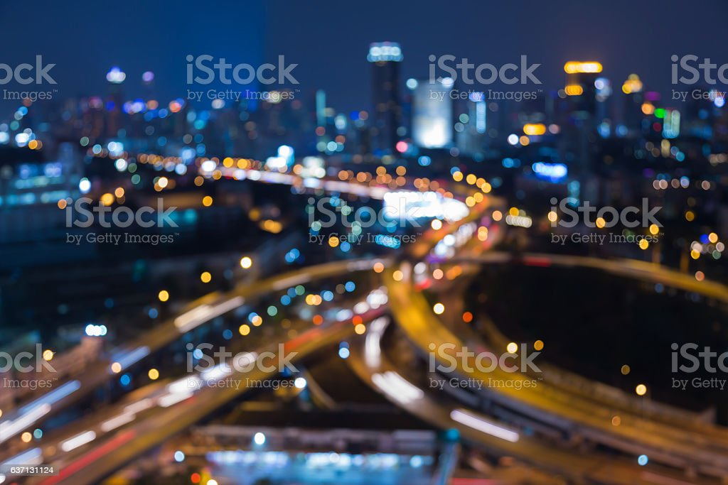 Blurred bokeh city and higway intersection aerial view stock photo