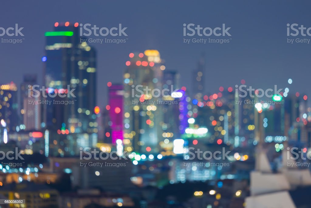 Blurred bokeh light night Office building downtown foto de stock royalty-free