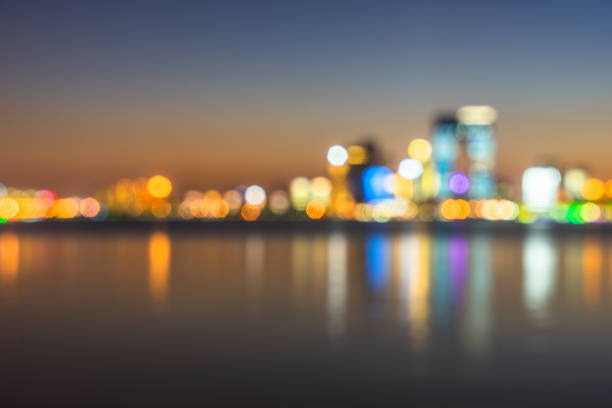 blurred bokeh light of city downtown - generic location stock pictures, royalty-free photos & images