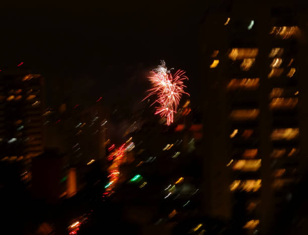 Blurred Buildings and fireworks. Buildings depicted with blurred effect and fireworks in the skies of the Pinheiros neighborhood, São Paulo, Brazil. reveillon stock pictures, royalty-free photos & images