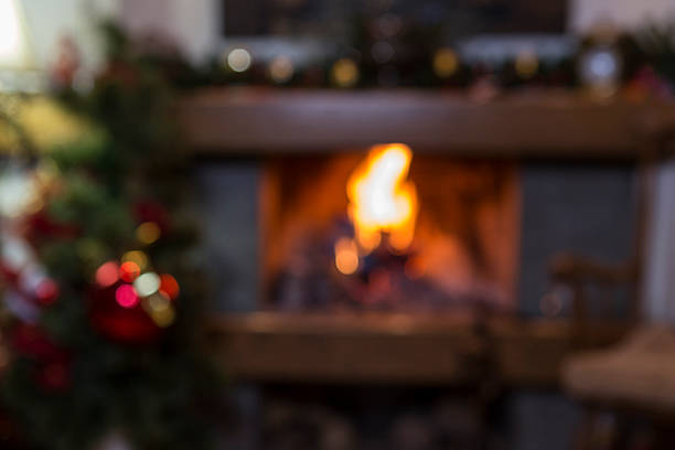 Blurred burning fireplace at home stock photo