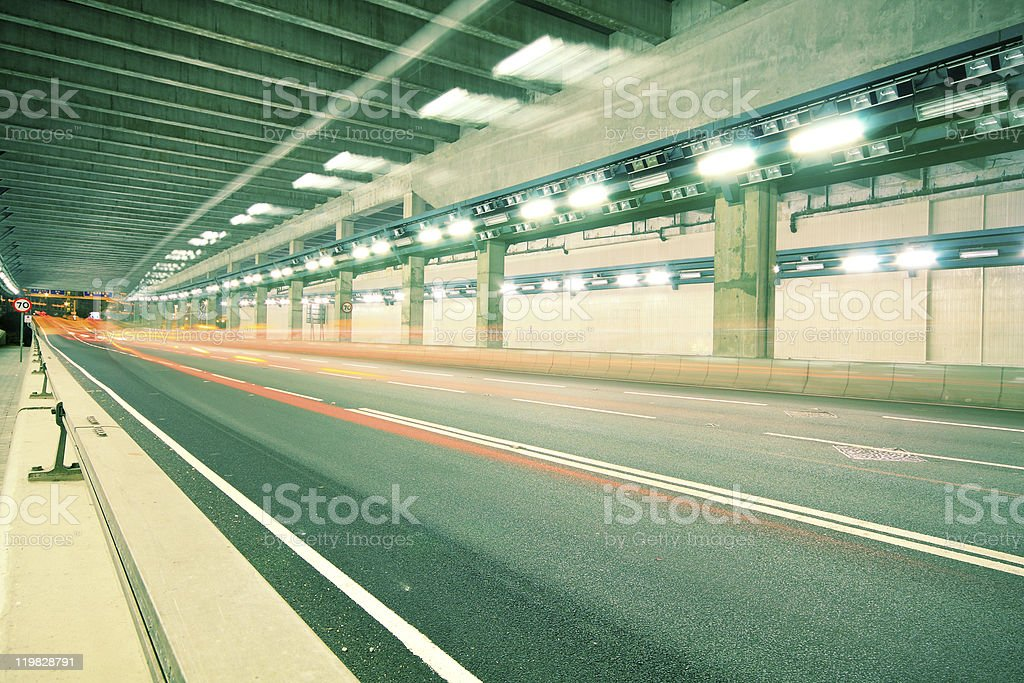 blurred bus light trails in downtown night-scape royalty-free stock photo