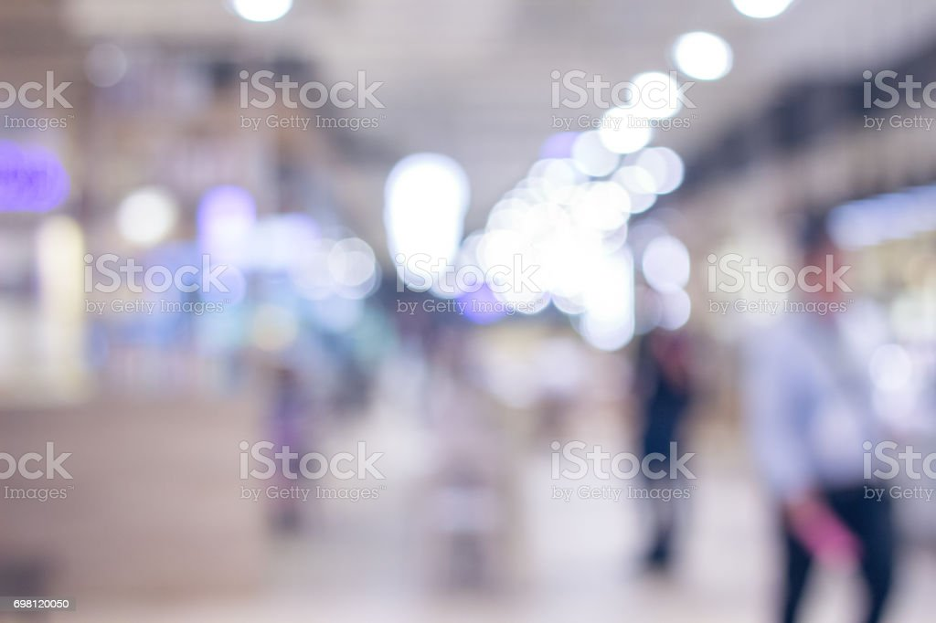 blurred business man walking stock photo