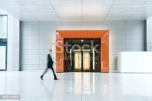 istock Blurred business man walking 924124502