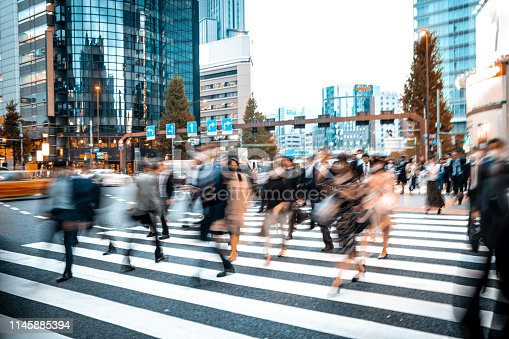 1146224410istockphoto Blurred business people on their way from work 1145885394