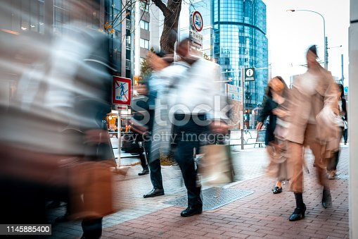 1146224410istockphoto Blurred business people on their way from work 1145885400