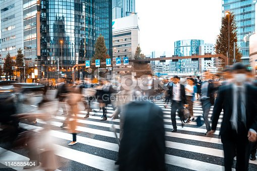 1146224410istockphoto Blurred business people on their way from work 1145885404