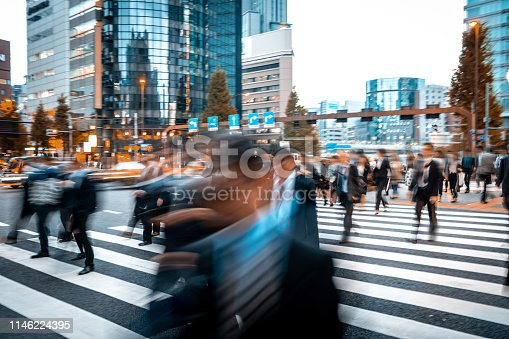 1146224410istockphoto Blurred business people on their way from work 1146224395