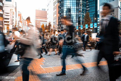 1146224410istockphoto Blurred business people on their way from work 1146224401