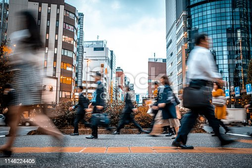 1146224410istockphoto Blurred business people on their way from work 1146224405
