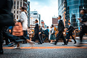 istock Blurred business people on their way from work 1146224410