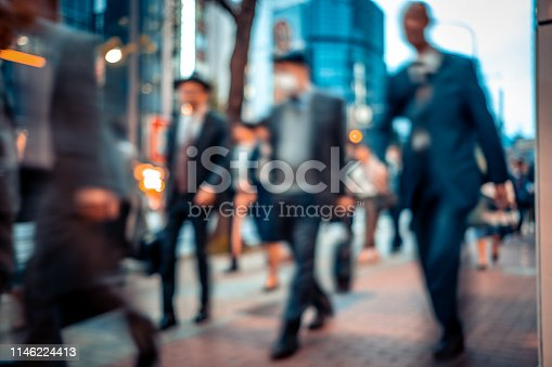 1146224410istockphoto Blurred business people on their way from work 1146224413