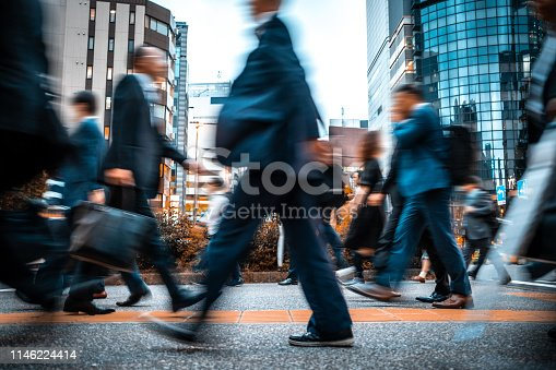 1146224410istockphoto Blurred business people on their way from work 1146224414