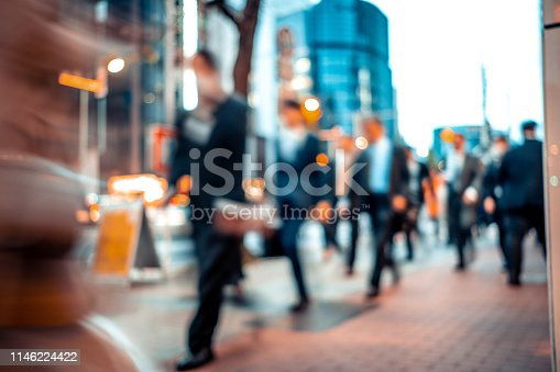 1146224410istockphoto Blurred business people on their way from work 1146224422