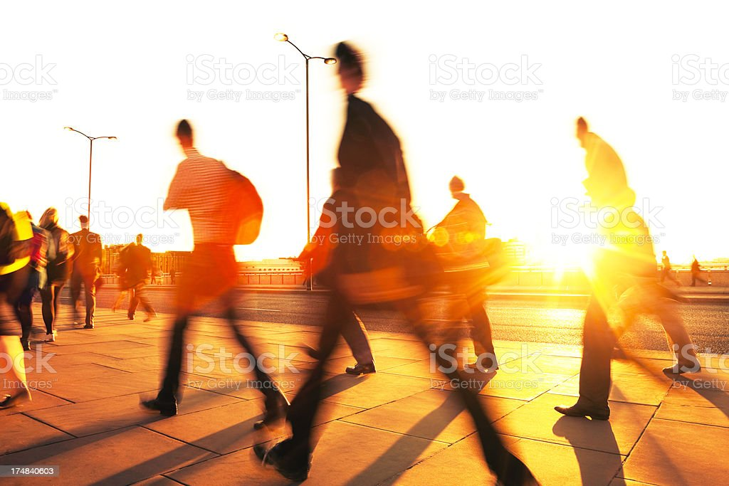 Blurred Business People Rushing in Sunset Light, London, England stock photo