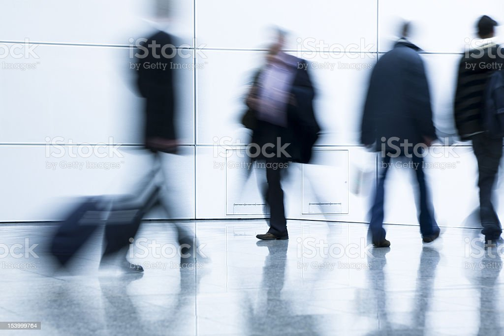 Blurred Business People Walking in a Corridor royalty-free stock photo