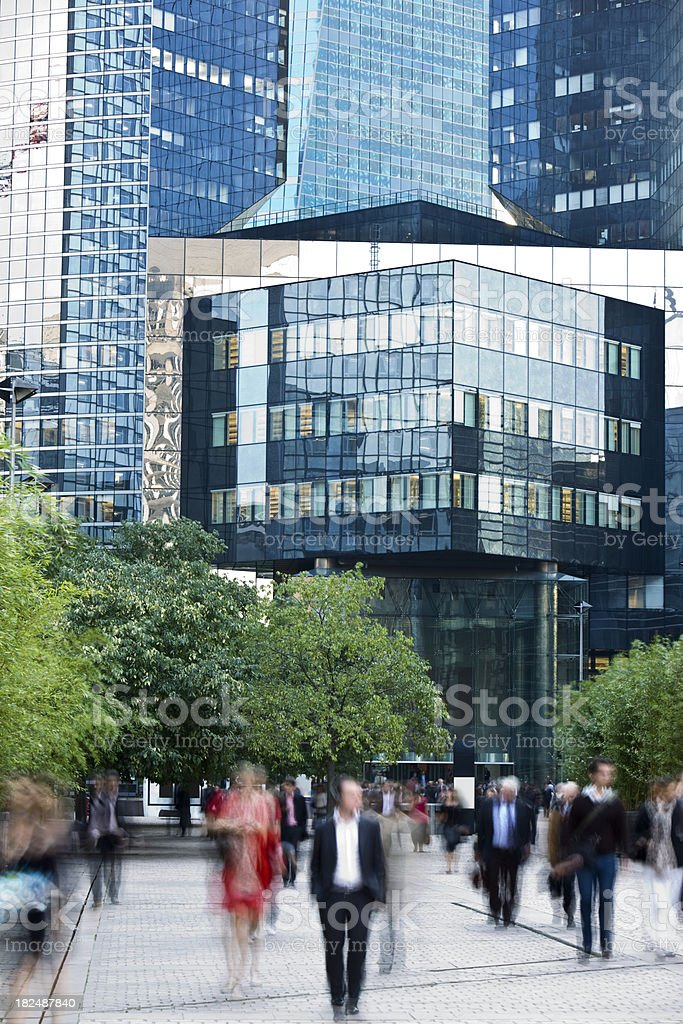 Blurred Business People Walking Outside Office Tower royalty-free stock photo