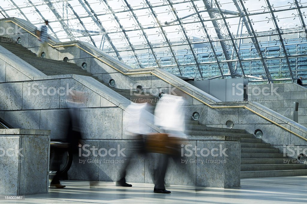 Blurred Businessmen Walking in Railway Station royalty-free stock photo