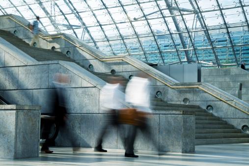 Blurred Businessmen Walking in Railway Station