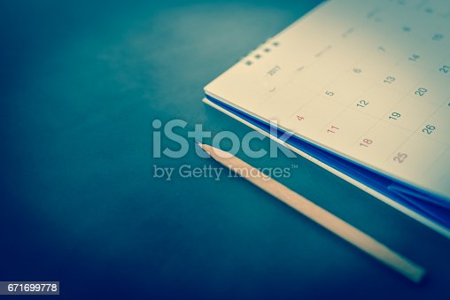 istock blurred calendar in planning concept on leather texture. 671699778