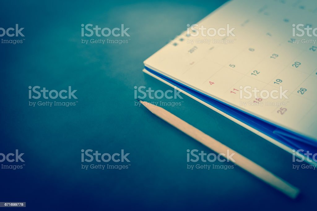 blurred calendar in planning concept on leather texture. stock photo