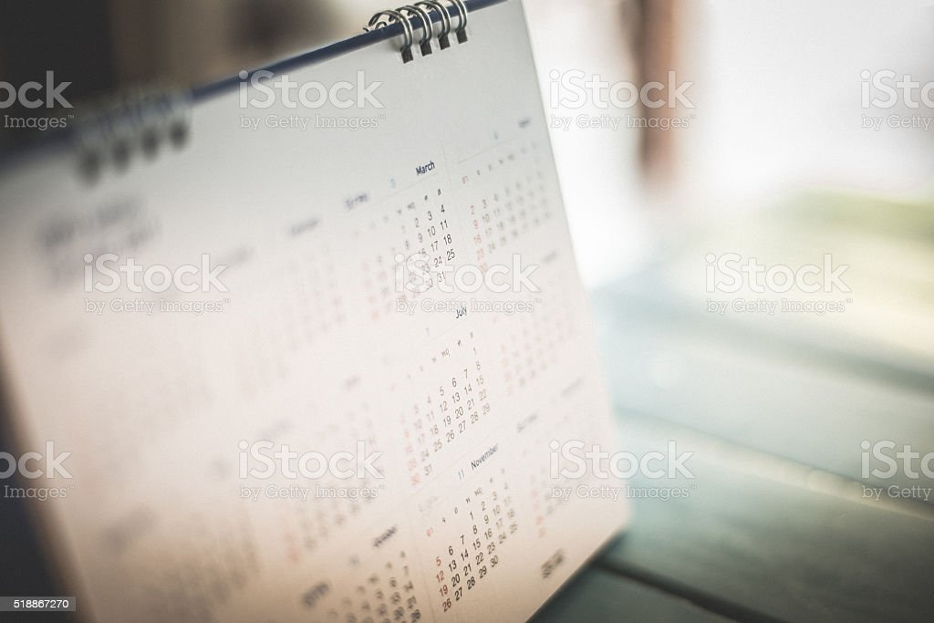 Blurred calendar page blue background. stock photo