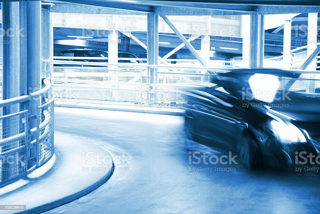 Blurred Car in Spiral Exit From Parking Garage royalty-free stock photo
