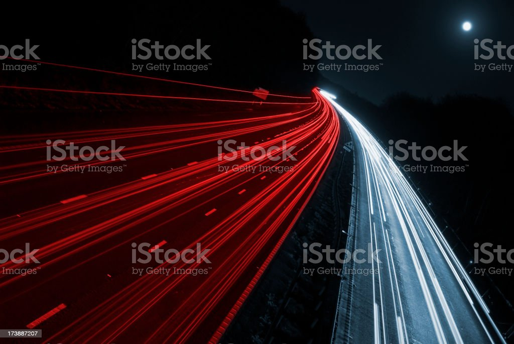 Blurred car lights from fast moving cars on motorway stock photo