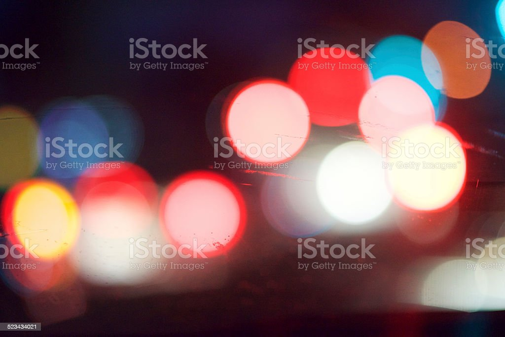 Blurred Car Lights Through a Windshield stock photo
