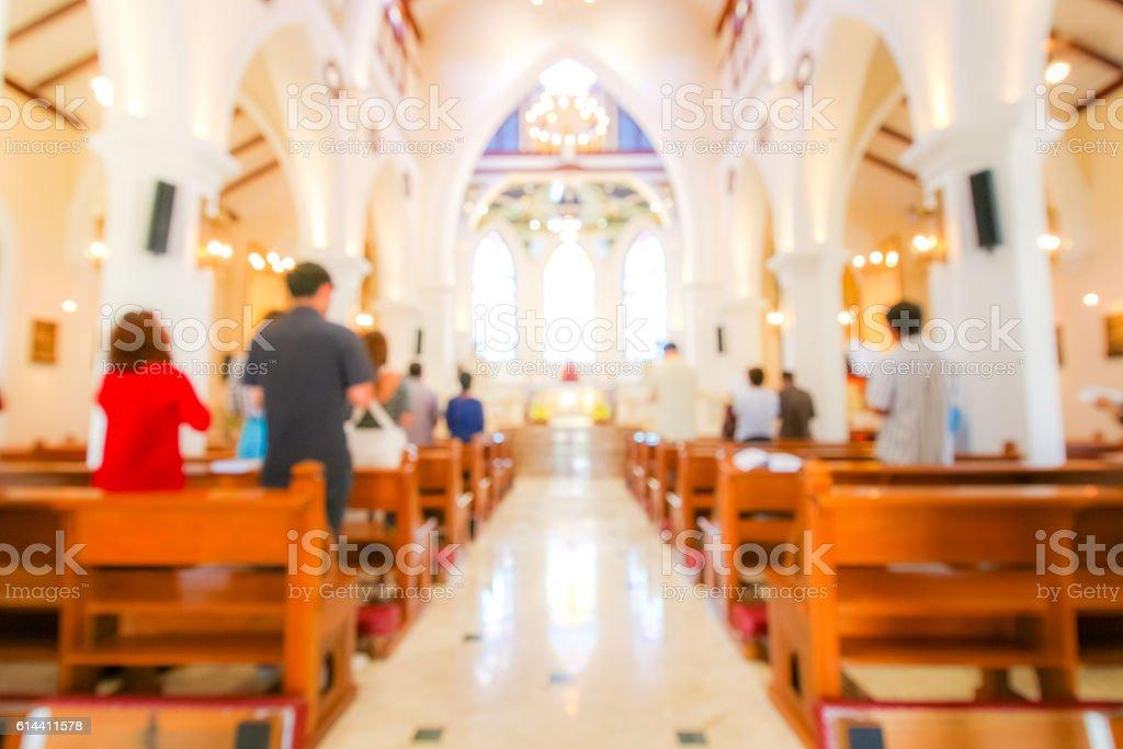 blurred christian mass praying inside the church stock photo