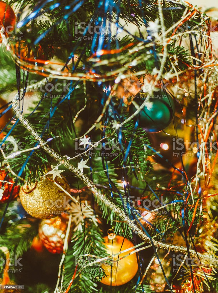 Blurred Christmas background with Christmas tree, Christmas tree decorations and tinsel royalty-free stock photo