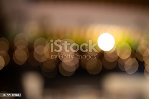 877010878 istock photo Blurred Christmas lights in a café 1072113500