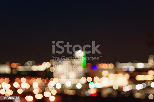 istock Blurred Christmas lights on a black background, bokeh. Light bokeh abstract. The concept of the new year 2018, holidays, vacation. 952366188