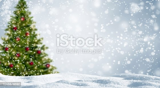blurred christmas tree in white snowy landscape