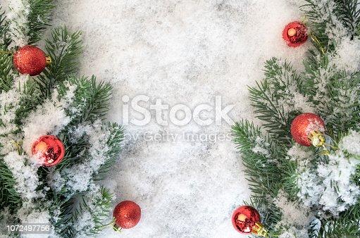 istock Blurred christmas tree, snow, christmas, light background. 1072497756