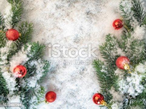 istock Blurred christmas tree, snow, christmas, light background. 1072497764