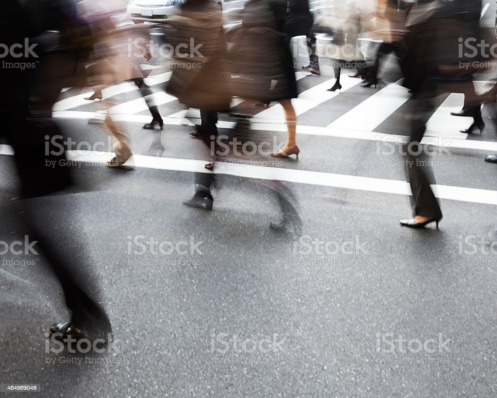 Blurred city commuters walk on a street stock photo