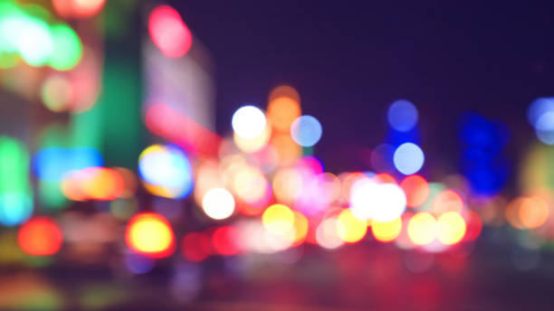 Blurred city lights at night, color toning applied. stock photo