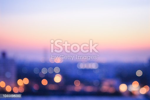 Bokeh light and blur city skyline autumn sunrise background
