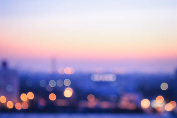 Blurred city sunrise background Bokeh light and blur city skyline autumn sunrise background twilight stock pictures, royalty-free photos & images